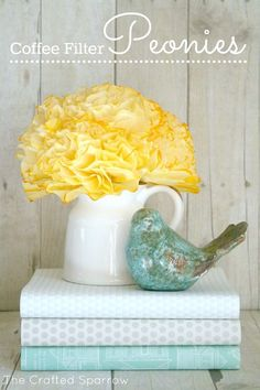 How to make inexpensive coffee filter peony flowers. Great summer decor. (Use scrapbook paper to cover hardback books like the ones in the picture)