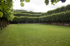 Incredibly picturesque private grass court. I'd take grass court tennis over golf any day!