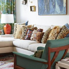 Moving In In the living room, the neutral sofa plays host to a genius mix of pillows, including animal prints and rich, nubby textiles.