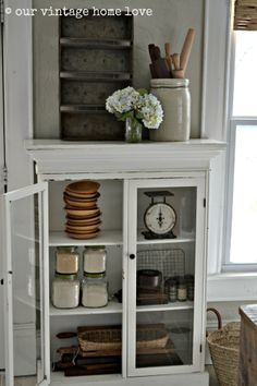 our vintage home love - I am in love with everything in her house.  Gotta keep my eye out for a skinnier version to replace the cookbook shelf & to fit canisters.  Awesome idea.