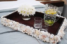 Just glue on seashells to plates, trays, mirrors! Just use a hot glue gun and pretty it up!