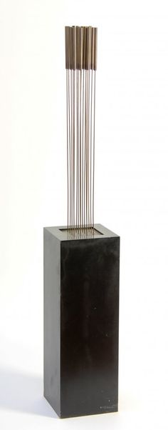 "Sold For $42,500  Harry Bertoia (Italy-USA, 1915-1978), Sonambient Sculpture, 1970's. Sixteen bronze tops silvered to sixteen beryllium copper rods silvered to brass base mounted onto a pedestal. Size: approximately 30"" height, on a 27"" x 9"" x 9"" pedestal, 57"" overall."