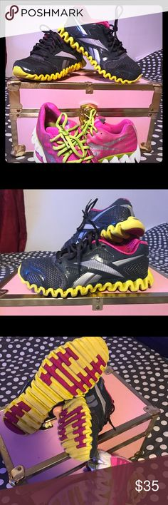 Comfy sneakers Reebok size 7.5 Beautiful confy sneakers zignano Reebok used but in really good condition dark gray with silver ,yellow and Pink colors. Reebok Shoes Sneakers