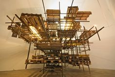 The Ruins, 2009, scaffold, pallets, ladders, 5 x turntables, on off timer and light chaser, cm 540x540x540; installation view at Monitor, Rome