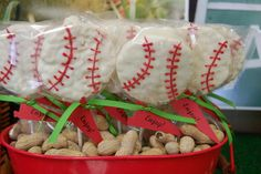 Rice Krispie treats shaped as baseballs, dipped in white chocolate and decorated to look like baseballs