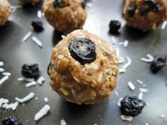Energy balls made with oats, coconut, dried blueberries and almond butter with vanilla protein powder for a protein boost! A great vegan and gluten free snack.