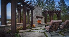 Outdoor fireplace design with a lake front view.  Zaremba and Company Clarkston, MI