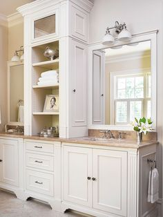 Love the open cabinet between the two sinks