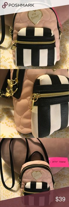 BETSY JOHNSON shoulder bag, mini backpack shape BETSY JOHNSON shoulder bag, backpack shape/style (mini). Pastel Pink, white and black. Super cute floral interior. New with tags. Betsey Johnson Bags Shoulder Bags
