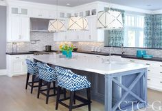 Blue and white kitchen with large center island | Connecticut Cottages & Gardens | February 2014