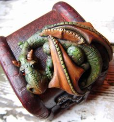 Dragon on miniature chest.