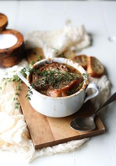 Make this Classic French Onion Soup Recipe with Crostini and Gruyere Cheese that is topped off with fresh thyme and perfect on cold days!