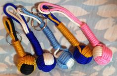 Paracord Monkey Ball Key Chain Zipper Pull Backpack Golf Volleyball Soccer Decoration  These Monkey Ball knots on a carabiner are so useful! They easily clip onto anything that needs a bigger pull handle....  such as keys (key chain), zipper (zipper pull)....etc.  Woven with: Type III Nylon 550-pound Tensile Strength 7 Inner Strands 4mm Diameter Rot Resistance UV Fading Resistance Durable Made in the USA  Woven by: Neesie Davis Sur La Petite (French for: About the Little Things)