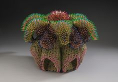 Usually you would expect the pencil to be the tool used to create the artwork, but in the case of Jennifer Maestre the pencil becomes the artwork. Jennifer has carefully and beautifully crafted a whole collection of dangerous looking sculptures made entirely out of colored pencils.