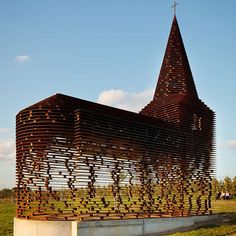 Dutch architects Pieterjan Gijs and Arnout Van Vaerenbergh made this chapel in Borgloon, Belgium, out of 100 evenly spaced planks of steel. The steeple and nave, constructed in 2011, are totally transparent at eye-level, but look solid from either above or below