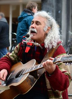 A street singer who pleased us for many years with a  great voice and many songs. His name is Moti....