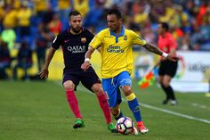 Momo of Las Palmas looks to hold off the incoming challenge from Jordi Alba of Barcelona during the La Liga match between UD Las Palmas and Barcelona at Estadio de Gran Canaria on May 14, 2017 in Las Palmas, Spain.