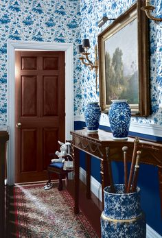 Blue and white toile wallcovering used for dramatic effect in a traditional foyer