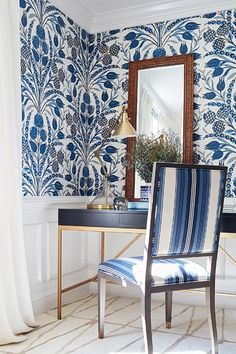A stunning large scale floral damask wallpaper design in a bold navy blue on white.