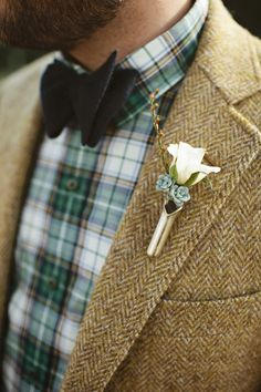 Green Wedding Accessories: Emerald goes rustic with this handsome groom attire. He layered a green plaid shirt with a neutral tweed jacket to create a fetching outfit for a casual wedding. | Elegant Emerald Green Wedding Details