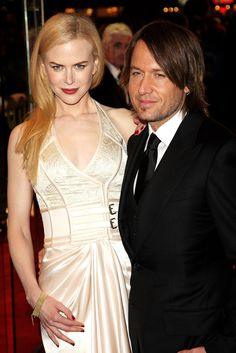 """Nicole Kidman and Keith Urban's wedding included a flowing Balenciaga gown and veil for the bride, and Tiffany clocks engraved with the words """"A Moment in Time"""" (valued at $350 each) as favors for the guests (June 25, 2006)."""