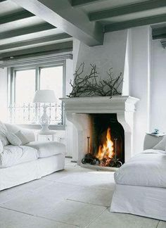 Don't favor white fireplace but the branches are a beautiful accent to a stoic mantle.