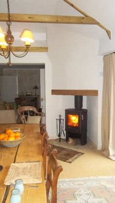 50-series Contura wood burning stove with false corner chimney breast.