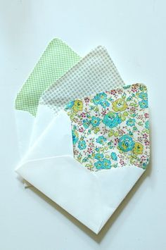 beautiful fabric lined envelopes. one of my friends recently used this idea for her wedding invitation envelopes.