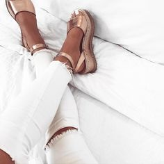 Trendy distressed white jeans with cute gold espadrilles.