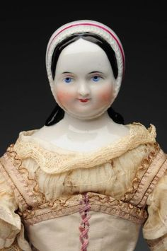 """Lot # : 25 - 12"""" China Doll with Rare Molded Bonnet."""