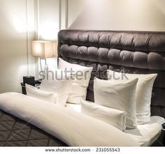Bed with pillows and headboard and a night table lamp to the left. - stock photo Night Table Lamps, Leather Headboard, Luxury Decor, Headboards For Beds, Good Night Sleep, Master Bedroom, Bed Pillows, Pillow Cases, Relax