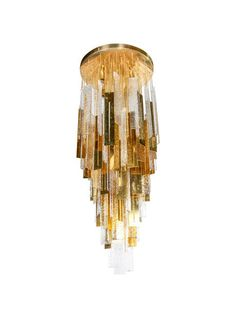 Spectacular large-scale chandelier comprised of alternating Murano glass and brass metal pendants, each hanging from their individual chain.  || TheHighBoy || #highboystyle #antiquesmakeitbetter #antiques #vintage #chandelier