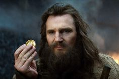 Liam Neeson as Zeus in Clash of the Titans. Male actor, portrait, beard, long hair, hand, photo