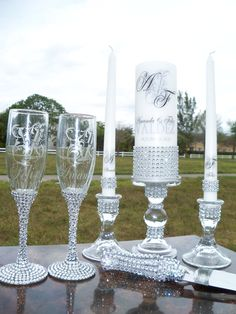 Lots of Bling .....Unity candle, Memorial candle, Holders, Flutes and Cake Server. $200.00, via Etsy.