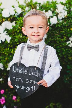 This cutie holds a sign at a wedding in Laguna Beach.
