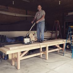 Floor sanding the shuffleboard table