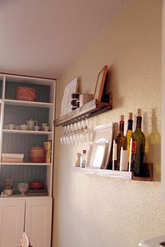 DIY Wall shelves with wine glass holder, made to mount directly to wall with screw and has lip on front.
