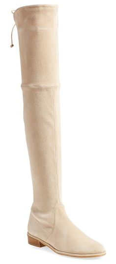 lowland over the knee boot by Stuart Weitzman. A single slim lace cinches the back of a luxe stretch-suede boot crafted in a showstopping over-the-knee silhouette. ...