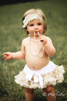 this could be so cute with the right little shirt on her.  Cute little girl- I like the classic pearls
