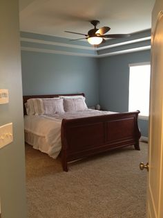 "Sherwin Williams ""Interesting Aqua"" paint in our master bedroom. Love it!"