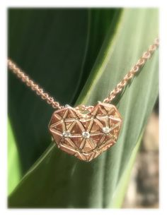 RUSTIC Heart & Triple Moissanite Pendant in Yellow or Rose Gold on a matching, plated, Stainless Steel chain.