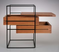 Floating wood planes in a blackened steel grid | Two Drawer Widdicomb Box by Widdicomb for The Planner Group