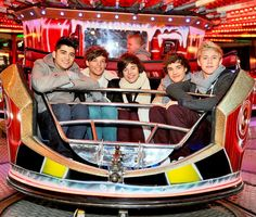 1D on a ride... Looks squished in there..