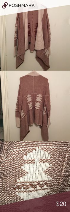 Aztec cardigan size 1x This super cute Aztec cardigan is a size 1x. Really warm and heavy. The content label is faded but I think it might have wool in it. Color is brown with oatmeal/khaki color. Jaime Sweaters Cardigans