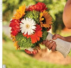 fall-colored sunflowers, spider mums and gerbera daisies.
