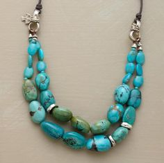 """A smattering of sterling silver lends polish to the more earthy beauty of veined turquoise beads. Handmade in USA exclusively for us with slip knots in the waxed cord to adjust the length from approx. 20"""" to 34""""L. Handmade in USA."""