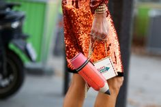 Don't: Hesitate to use the things commonly inside your bag as actual bags. #refinery29 http://www.refinery29.com/2014/10/75565/paris-street-style-photos-fashion-week-2014#slide-2
