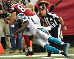 Panthers Falcons Football Atlanta Falcons tight end Jacob Tamme (83) scores a touchdown against Carolina Panthers outside linebacker Thomas Davis (58) during the first half of an NFL football game, Sunday, Oct. 2, 2016, in Atlanta. (AP Photo/Rainier Ehrhardt)