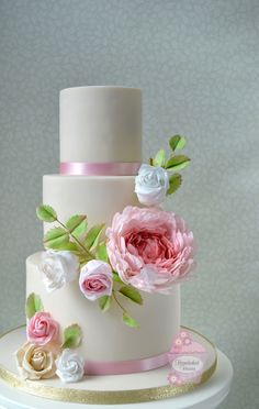 Wedding cake decorated with sugar flowers ~ peony, roses and rosebuds to match the bride's fresh ones.