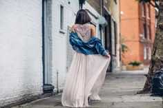Anisa Sojka styles dusty pink Day Birger Et Mikkelsen elba silk maxi dress | Blue denim jean jacket off the shoulders | Black and gold round classic Rayban sunglasses | Brunette straight shoulder length hair let loose | Fashion blogger street style shot in London by Moeez Ali